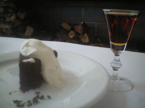 chocolate cake with a glass of nonino amaro